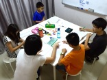 Students in small group format within easy access to tutor Yuet Ling